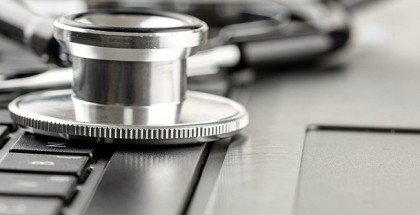 Stethoscope lying on a laptop keyboard